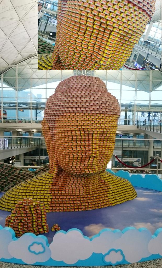 China, Hong Kong, lotnisko, rzeźba buddy z puszek rybnych